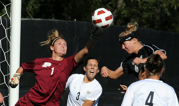 """Keeper Carianne Betts, left, of Purdue, knocks away a head shot by Amy Barczuk of Colorado on Friday.<br /> For more photos from the game, go to  <a href=""""http://www.dailycamera.com"""">http://www.dailycamera.com</a>.<br />  Cliff Grassmick / September 17, 2010"""