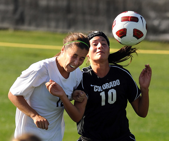"Tayler Francel, left, of Purdue, and Kassidy Fitzpatrick of CU, connect on the header on Friday.<br /> For more photos from the game, go to  <a href=""http://www.dailycamera.com"">http://www.dailycamera.com</a>.<br />  Cliff Grassmick / September 17, 2010"
