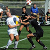 "Jessica Warren, left, of Purdue, and Alex Dohm of CU battle for position on Friday.<br /> For more photos from the game, go to  <a href=""http://www.dailycamera.com"">http://www.dailycamera.com</a>.<br />  Cliff Grassmick / September 17, 2010"