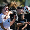 "Marta Lynch, left, of Purdue, and Alex Dohm of CU, battle on the header on Friday.<br /> For more photos from the game, go to  <a href=""http://www.dailycamera.com"">http://www.dailycamera.com</a>.<br />  Cliff Grassmick / September 17, 2010"