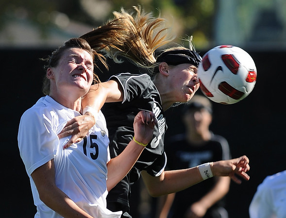 """Marta Lynch, left, of Purdue, and Alex Dohm of CU, battle on the header on Friday.<br /> For more photos from the game, go to  <a href=""""http://www.dailycamera.com"""">http://www.dailycamera.com</a>.<br />  Cliff Grassmick / September 17, 2010"""