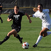 "Hayley Hughes, left, of CU, and Katie Leinert of Purdue, run to control the pass.<br /> For more photos from the game, go to  <a href=""http://www.dailycamera.com"">http://www.dailycamera.com</a>.<br />  Cliff Grassmick / September 17, 2010"