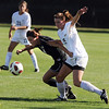 "Amanda Foulk, left, of CU, and Marta Lynch of Purdue, battle for control of the ball on Friday.<br /> For more photos from the game, go to  <a href=""http://www.dailycamera.com"">http://www.dailycamera.com</a>.<br />  Cliff Grassmick / September 17, 2010"