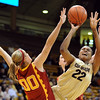 "Brittany Spears of CU drives past  Christina Marinacci of USC.<br /> For more photos of the game, go to  <a href=""http://www.dailycamera.com"">http://www.dailycamera.com</a>.<br /> Cliff Grassmick / March 27, 2011"