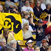 A University of Colorado fan cheers between fans of both teams during the 2011  WNIT  game against Southern California on Sunday, March 27, at the Coors Event Center on the CU campus in Boulder.<br /> The Buffs lost the game 87-70.<br />  Jeremy Papasso/ Camera
