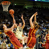 University of Colorado sophomore Meagan Malcolm-Peck gets fouled by a Trojan defender while driving to the basket during the 2011  WNIT  game against Southern California on Sunday, March 27, at the Coors Event Center on the CU campus in Boulder.<br /> The Buffs lost the game 87-70.<br />  Jeremy Papasso/ Camera