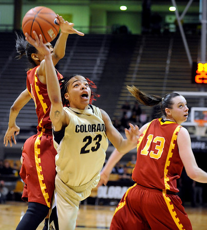 University of Colorado sophomore Chucky Jeffery drives to the hoop during the 2011  WNIT  game against Southern California on Sunday, March 27, at the Coors Event Center on the CU campus in Boulder.<br />  Jeremy Papasso/ Camera