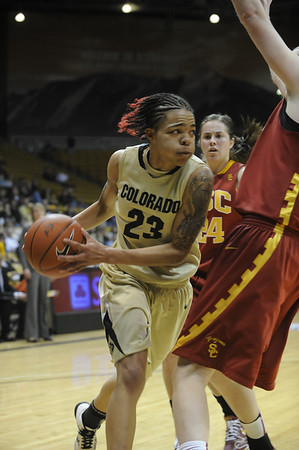 University of Colorado sophomore Chucky Jeffery looks to pass the ball during the 2011  WNIT  game against Southern California on Sunday, March 27, at the Coors Event Center on the CU campus in Boulder.<br /> The Buffs lost the game 87-70.<br />  Jeremy Papasso/ Camera
