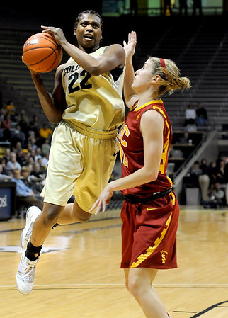 University of Colorado senior Brittany Spears drives to the hoop during the 2011  WNIT  game against Southern California on Sunday, March 27, at the Coors Event Center on the CU campus in Boulder.<br />  Jeremy Papasso/ Camera