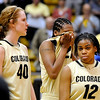 University of Colorado senior Brittany Spears, center, shows her emotion after losing to Southern California during the 2011  WNIT  game on Sunday, March 27, at the Coors Event Center on the CU campus in Boulder.<br /> The Buffs lost the game 87-70.<br />  Jeremy Papasso/ Camera