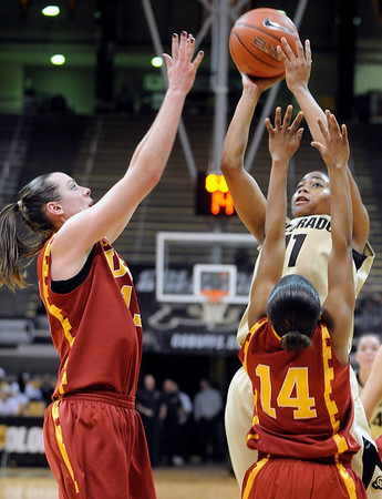 University of Colorado freshman Brittany Wilson takes a shot over California's Len'nique Brown during the 2011  WNIT  game against Southern California on Sunday, March 27, at the Coors Event Center on the CU campus in Boulder.<br /> The Buffs lost the game 87-70.<br />  Jeremy Papasso/ Camera