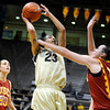 University of Colorado sophomore Chucky Jeffery takes a shot over California's Kari LaPlante during the 2011  WNIT  game against Southern California on Sunday, March 27, at the Coors Event Center on the CU campus in Boulder.<br />  Jeremy Papasso/ Camera