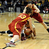 University of Colorado freshman Brittany Wilson fights for the ball with California's Kari LaPlante during the 2011  WNIT  game against Southern California on Sunday, March 27, at the Coors Event Center on the CU campus in Boulder.<br /> The Buffs lost the game 87-70.<br />  Jeremy Papasso/ Camera