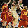 "Brittany Spears of CU drives between Jacki Gemelos (23) and Christina Marinacci of USC.<br /> For more photos of the game, go to  <a href=""http://www.dailycamera.com"">http://www.dailycamera.com</a>.<br /> Cliff Grassmick / March 27, 2011"