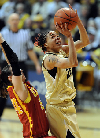 "Chucky Jeffery of CU puts up a shot in front of Ashley Corral of USC.<br /> For more photos of the game, go to  <a href=""http://www.dailycamera.com"">http://www.dailycamera.com</a>.<br /> Cliff Grassmick / March 27, 2011"