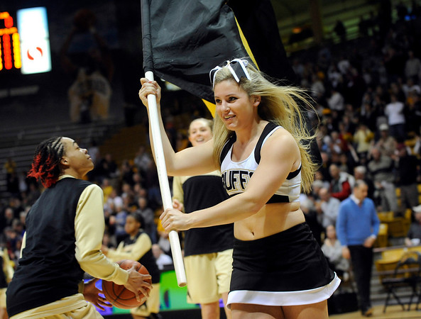 University of Colorado cheerleader shows team spirit before the start of the 2011 WNIT game against Southern California on Sunday, March 27, at the Coors Event Center on the CU campus in Boulder.<br /> The Buffs lost the game 87-70.<br />  Jeremy Papasso/ Camera