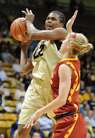 """Brittany Spears of CU drives past  Christina Marinacci of USC.<br /> For more photos of the game, go to  <a href=""""http://www.dailycamera.com"""">http://www.dailycamera.com</a>.<br /> Cliff Grassmick / March 27, 2011"""