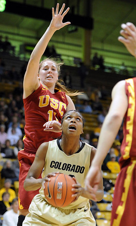 "Brittany Spears of CU drives past  Kari LaPlante of USC.<br /> For more photos of the game, go to  <a href=""http://www.dailycamera.com"">http://www.dailycamera.com</a>.<br /> Cliff Grassmick / March 27, 2011"