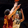 University of Colorado sophomore Chucky Jeffery takes a shot over California's Jacki Gemelos during the 2011  WNIT  game against Southern California on Sunday, March 27, at the Coors Event Center on the CU campus in Boulder.<br /> The Buffs lost the game 87-70.<br />  Jeremy Papasso/ Camera