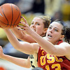 Julie Seabrook, left, of Colorado, and Kari LaPlane of Southern California, both reach for a loose ball during the second half of a WNIT game on March 27, 2011 in Boulder.<br /> Cliff Grassmick / March 27, 2011