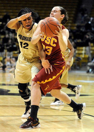 University of Colorado freshman Ashley Wilson tries to steal the ball from California's Jacki Gemelos during the 2011  WNIT  game against Southern California on Sunday, March 27, at the Coors Event Center on the CU campus in Boulder.<br /> The Buffs lost the game 87-70.<br />  Jeremy Papasso/ Camera