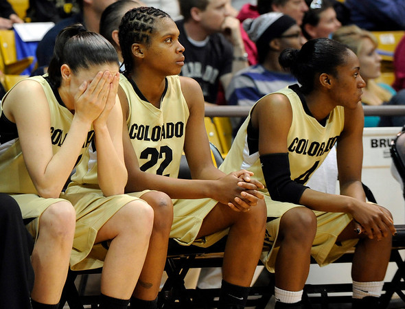 University of Colorado senior Chelsea Dale, left, shows her emotion in the final seconds of the game while sitting next to teammates Brittany Spears, center, and Britney Blythe, right, during the 2011  WNIT  game against Southern California on Sunday, March 27, at the Coors Event Center on the CU campus in Boulder.<br /> The Buffs lost the game 87-70.<br />  Jeremy Papasso/ Camera