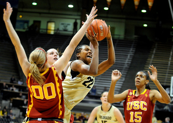 University of Colorado senior Brittany Spears takes a shot over California's Christina Marinacci during the 2011  WNIT  game against Southern California on Sunday, March 27, at the Coors Event Center on the CU campus in Boulder.<br />  Jeremy Papasso/ Camera