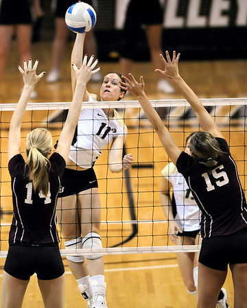Colorado's Rosie Steinhaus (middle) spikes the ball over A&M's Lindsey Miller (left) and Jennifer Banse (right)  during their vollyball game at University of Colorado in Boulder, Colorado November 25, 2009. CAMERA/Mark Leffingwell