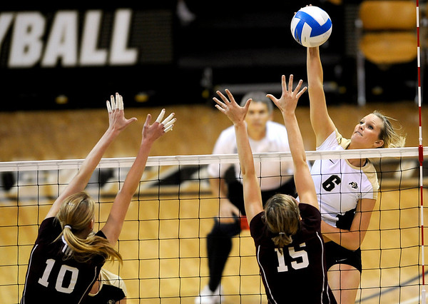 Colorado's Kerra Schroeder (right) spikes the ball past A&M's Alisia Kastmo (left) and Jennifer Banse (middle) during their vollyball game at University of Colorado in Boulder, Colorado November 25, 2009. CAMERA/Mark Leffingwell