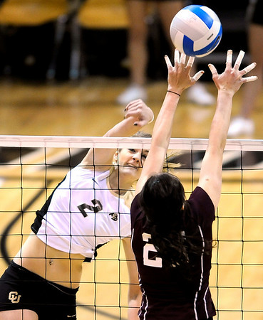Colorado's Schylur Edelman (left) gets a kill shot past A&M's Mary Batis (right) during their vollyball game at University of Colorado in Boulder, Colorado November 25, 2009. CAMERA/Mark Leffingwell