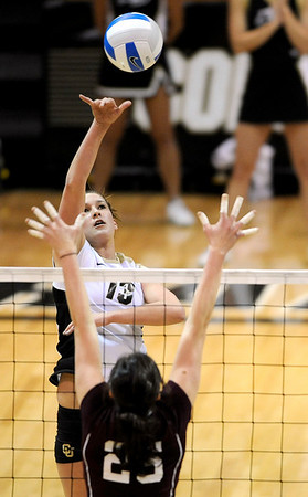 Colorado's Megan Cyr (back) lofts the ball over the hands of A&M's Mary Batis (front) during their vollyball game at University of Colorado in Boulder, Colorado November 25, 2009. CAMERA/Mark Leffingwell