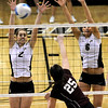 Colorado's Schylur Edelman (left) and Kerra Schroeder (right) block a shot from A&M's Mary Batis (middle) during their vollyball game at University of Colorado in Boulder, Colorado November 25, 2009. CAMERA/Mark Leffingwell