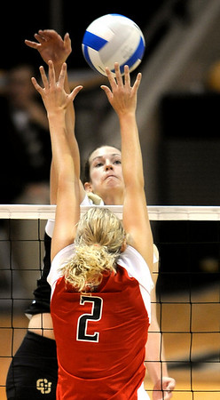 Colorado's Rosie Steinhaus (back) gets kill shot past Texas Tech's Caroline Courtney (front) during their volleyball game at the University of Colorado in Boulder, Colorado October 14, 2009.  CAMERA/Mark Leffingwell