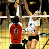 Colorado's Kerra Schroeder (R) spikes the ball past Texas Tech's Miara Cave (L) during their volleyball game at the University of Colorado in Boulder, Colorado October 14, 2009.  CAMERA/Mark Leffingwell