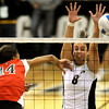 Colorado's Nikki Kinzer (right) blocks a shot from Texas Tech's Barbara Conceicao (left) during their volleyball game at the University of Colorado in Boulder, Colorado October 14, 2009.  CAMERA/Mark Leffingwell