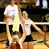 Colorado's Rosie Steinhaus (right) lofts the ball over Texas Tech's Hayley Ball (left) during their volleyball game at the University of Colorado in Boulder, Colorado October 14, 2009.  CAMERA/Mark Leffingwell