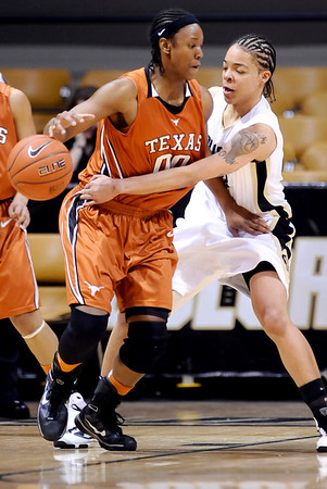 Colorado's Chucky Jeffery (right) knocks the ball from Texas' Earnesia Williams (left) during their basketball game at University of Colorado in Boulder, Colorado February 10, 2010.  CAMERA/Mark Leffingwell