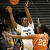 Colorado's Courtney Dunn (left) passes over Texas' Ashley Gayle (right) during their basketball game at University of Colorado in Boulder, Colorado February 10, 2010.  CAMERA/Mark Leffingwell