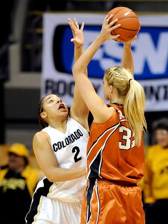 Colorado's Bianca Smith (left) guards Texas'Kristen Nash (right)  during their basketball game at University of Colorado in Boulder, Colorado February 10, 2010.  CAMERA/Mark Leffingwell