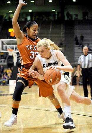Colorado's Alyssa Fressle (right) drives in while being guarded by Texas' Ashleigh Fontenette (left) during their basketball game at University of Colorado in Boulder, Colorado February 10, 2010.  CAMERA/Mark Leffingwell