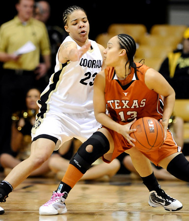 Colorado's Chucky Jerrery (left) guards Texas' Lauren Flores (right) during their basketball game at University of Colorado in Boulder, Colorado February 10, 2010.  CAMERA/Mark Leffingwell