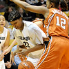 Colorado's Brittney Spears (left) looses control of the ball while being pressured by Texas' Yvonne Anderson (rigth) during their basketball game at University of Colorado in Boulder, Colorado February 10, 2010.  CAMERA/Mark Leffingwell