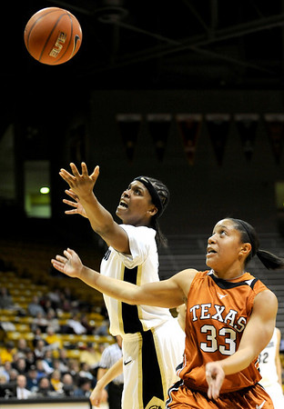 Colorado's Brittney Spears (left) and Texas' Ashleigh Fontenette (right) go for a rebound during their basketball game at University of Colorado in Boulder, Colorado February 10, 2010.  CAMERA/Mark Leffingwell