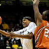 Colorado's Brittany Spears (left) attemps a layup while being pressured by Texas' Ashley Gayle (right) during their basketball game at University of Colorado in Boulder, Colorado February 10, 2010.  CAMERA/Mark Leffingwell