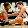 Colorado's Melissa MacFarlane (right) and Texas' Yvonne Anderson (left) go after a loose ball during their basketball game at University of Colorado in Boulder, Colorado February 10, 2010.  CAMERA/Mark Leffingwell