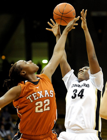 Texas' Ashley Gayle (left) knocks the ball from Colorado's Courtney Dunn (right)  during their basketball game at University of Colorado in Boulder, Colorado February 10, 2010.  CAMERA/Mark Leffingwell