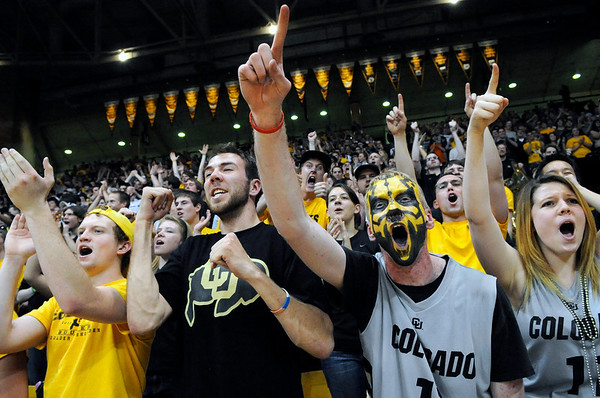 "University of Colorado senior Erin Halin, right, senior Matt Knoch, center, and freshman Cameron Cowart show their excitement after a CU basket during the second round of the NIT basketball tournament against the University of California on Friday, March 18, at the Coors Event Center in Boulder. For more photos go to  <a href=""http://www.dailycamera.com"">http://www.dailycamera.com</a><br /> Jeremy Papasso/ Camera"