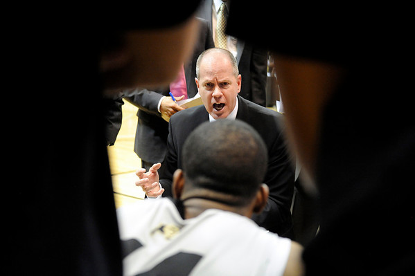 """University of Colorado Head Coach Tad Boyle sets a game plan with his team during a timeout during the second round of the NIT basketball tournament against the University of California on Friday, March 18, at the Coors Event Center in Boulder. For more photos go to  <a href=""""http://www.dailycamera.com"""">http://www.dailycamera.com</a><br /> Jeremy Papasso/ Camera"""