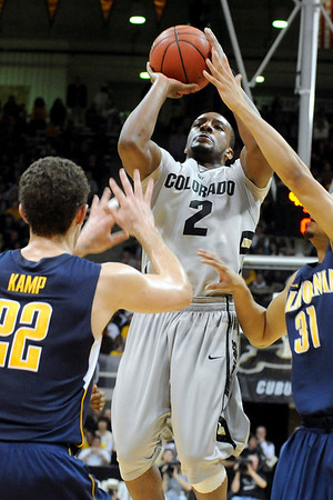 """University of Colorado freshman Shannon Sharpe takes a shot over California defenders during the second round of the NIT basketball tournament against the University of California on Friday, March 18, at the Coors Event Center in Boulder. For more photos go to  <a href=""""http://www.dailycamera.com"""">http://www.dailycamera.com</a><br /> Jeremy Papasso/ Camera"""