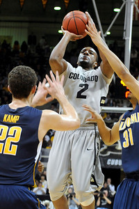 University of Colorado freshman Shannon Sharpe takes a shot over California defenders during the second round of the NIT basketball tournament against the University of California on Friday, March 18, at the Coors Event Center in Boulder. For more photos go to www.dailycamera.com Jeremy Papasso/ Camera